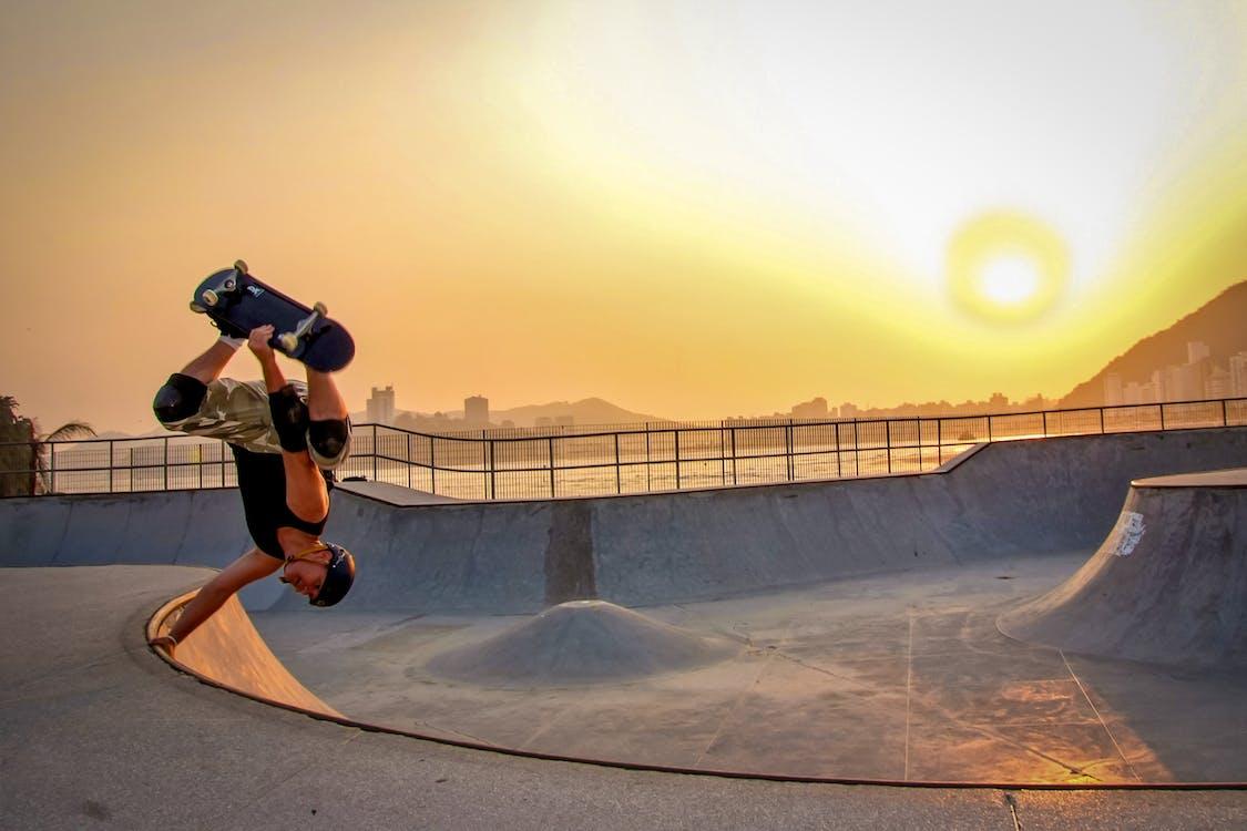 Man In Black Tank Top Skateboarding Wearing Helmet