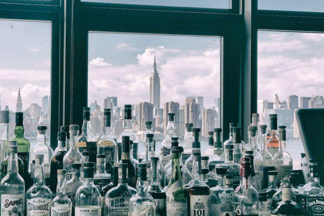 Assorted Bottles Near Windows