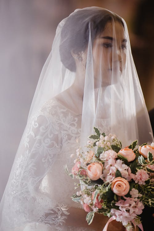A Bride in White Wedding Dress and Veil