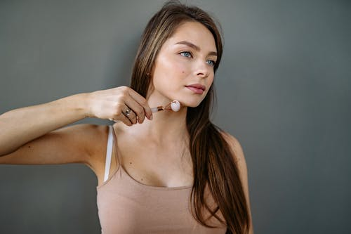 Woman Using Roller Jade on Her Chin