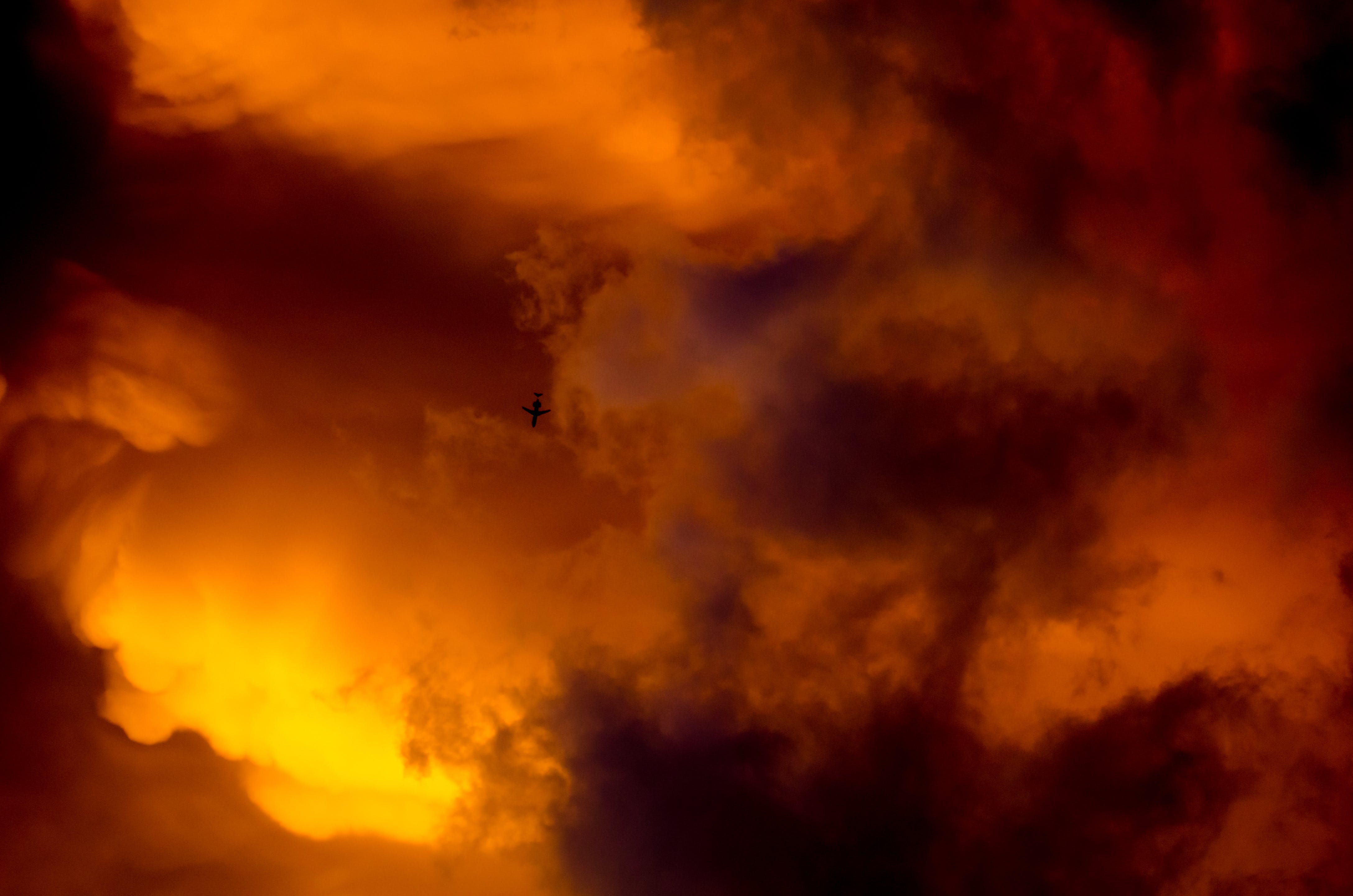 Airplane Silhouette and Orange Sky