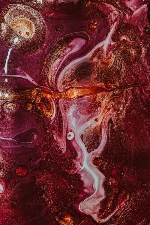 Abstract background of wet acrylic paints mixing on surface