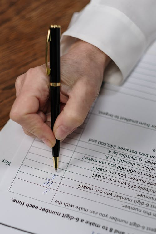 Close-Up Shot of a Person Checking Papers