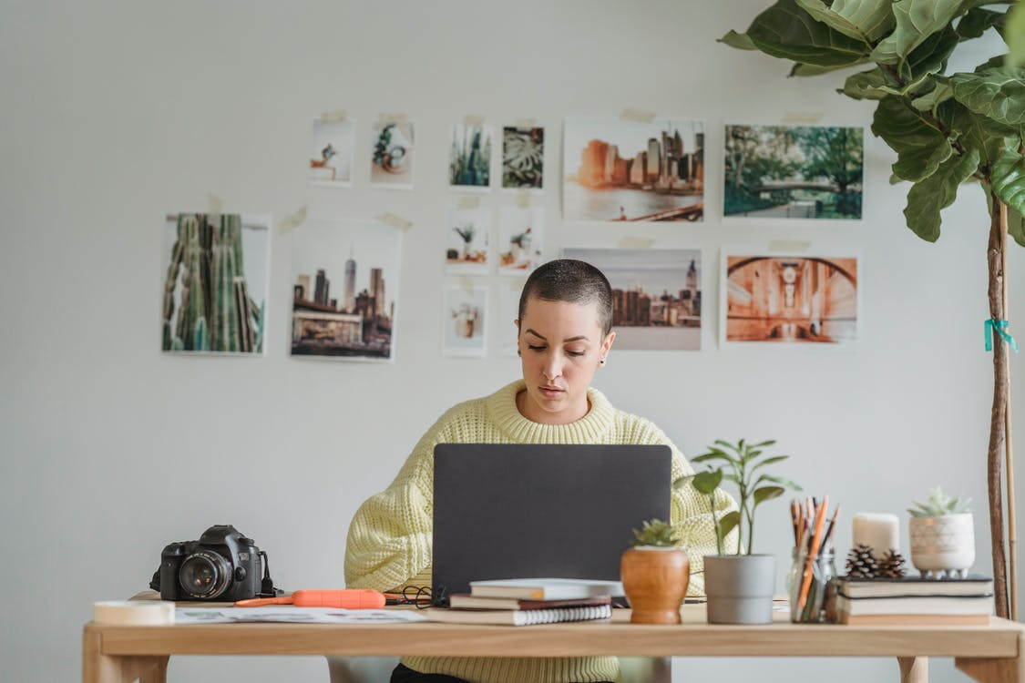 Concentrated woman working on laptop in office