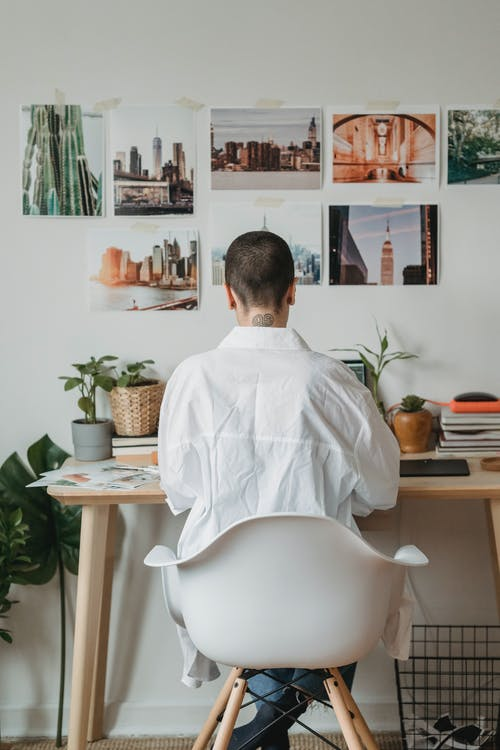 Faceless woman working on laptop at desk