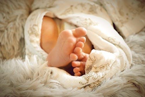 Babys Feet on White Textile