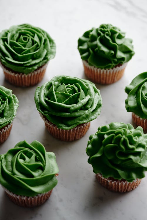 Close-Up Shot of Cupcakes with Green Frosting