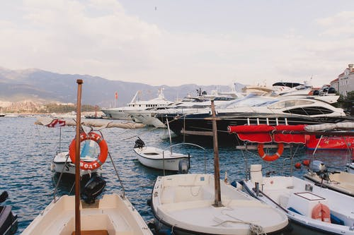 Pier with big yachts and motor boats