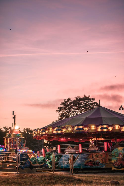 Carousel in amusement park during sunset
