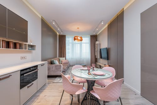 Interior of modern kitchen and dining zone in apartment