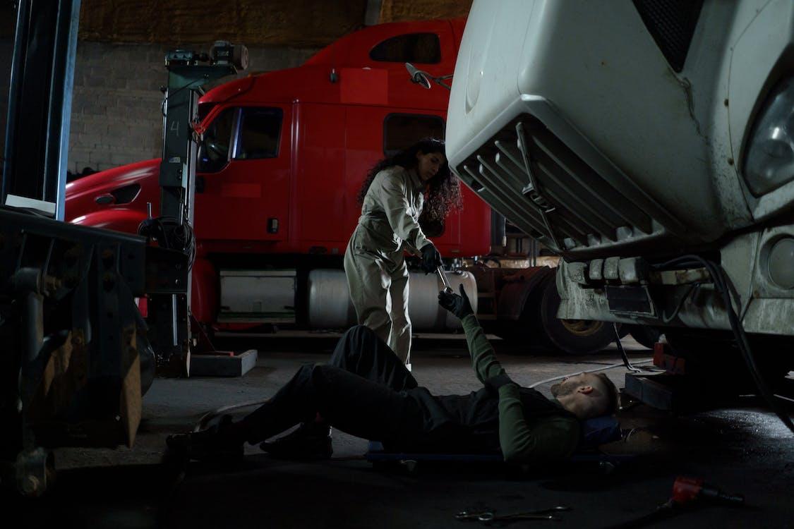 Man in Gray Jacket Lying on Floor