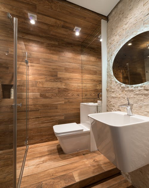 Contemporary washroom with creative sink and mirror