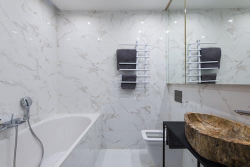 Light bathroom with bathtub and stylish sink