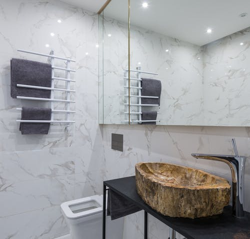 Stylish bathroom interior with toilet bowl and sink