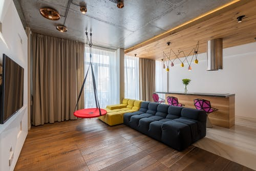 Interior of modern studio apartment furnished with sofa and counter