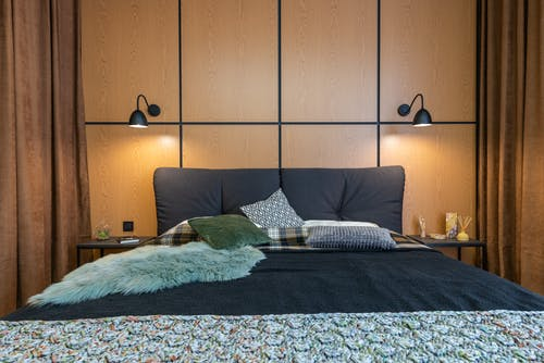 Stylish interior of bedroom with glowing lamps