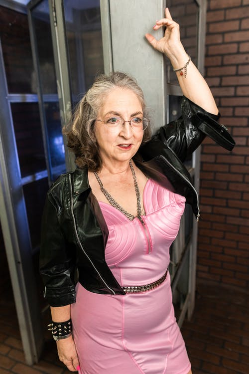 Woman in Pink Dress and Black Leather Jacket