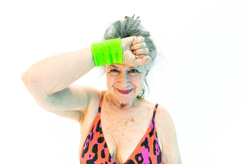 Woman Wearing Green Wristband With Hand On Her Forehead