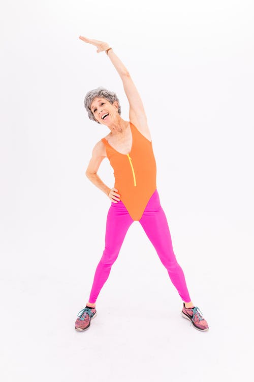 Woman in Yellow Tank Top and Pink Pants