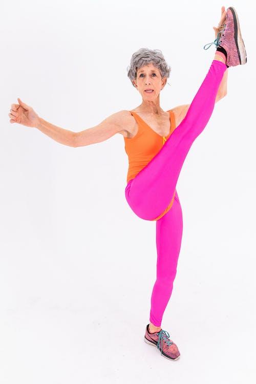 Woman in Pink Tank Top and Pink Leggings