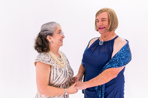 Two Elderly Women Holding Each Other's Hands