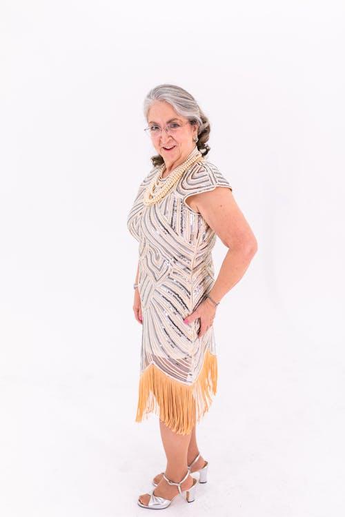 Elderly Woman in White and Orange Dress