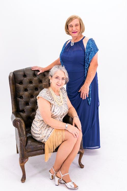 Portrait Of Two Elderly Women In Fashionable Dresses
