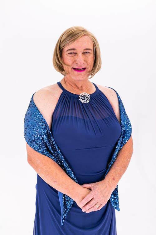 Elderly Woman in Blue Dress