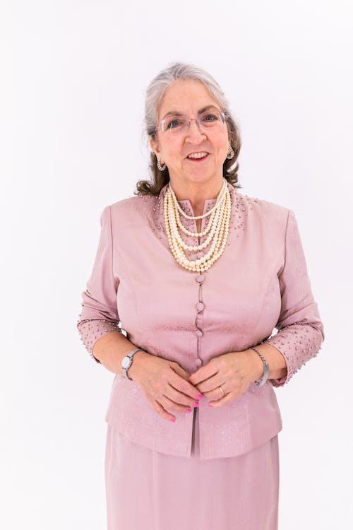 Elderly Woman in Pink Long Sleeve Dress