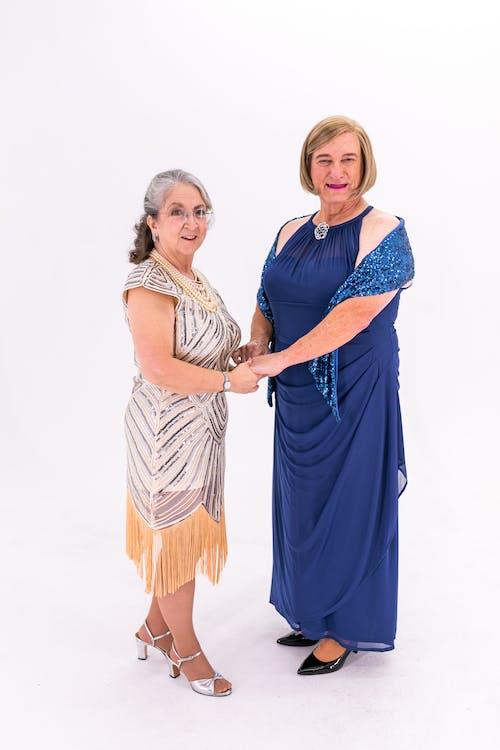 Two Elderly Women In Elegant Dresses
