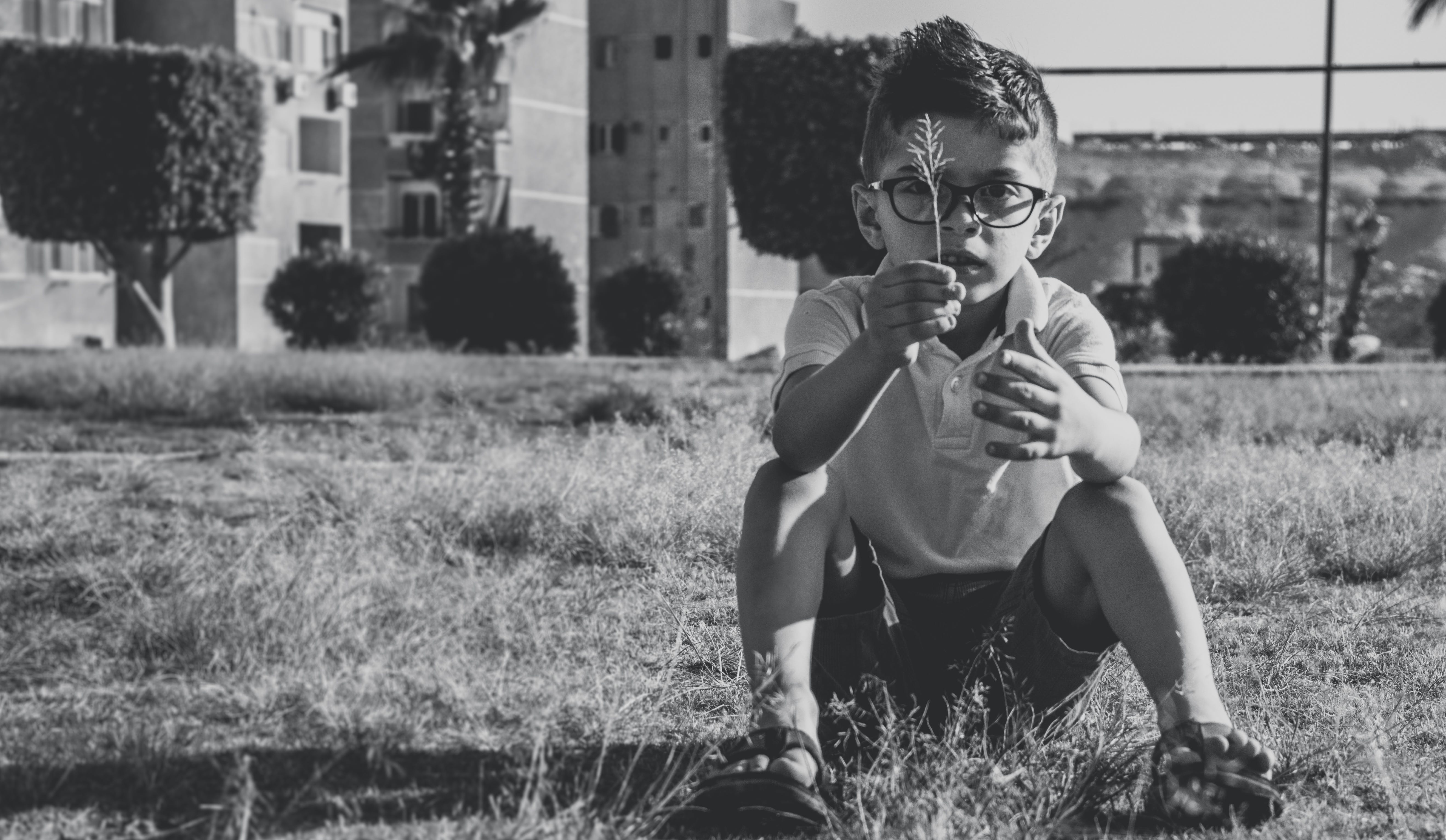 Greyscale Photo Of Boy Wearing Eyeglasses