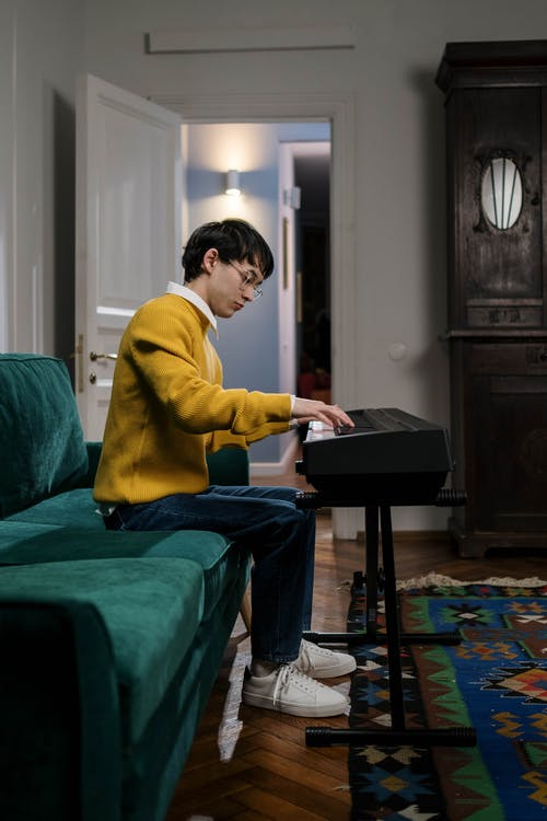 A Man Playing Piano Near the Doorway