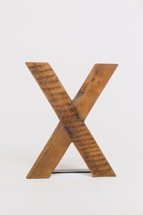 Brown Wooden Cross on White Background
