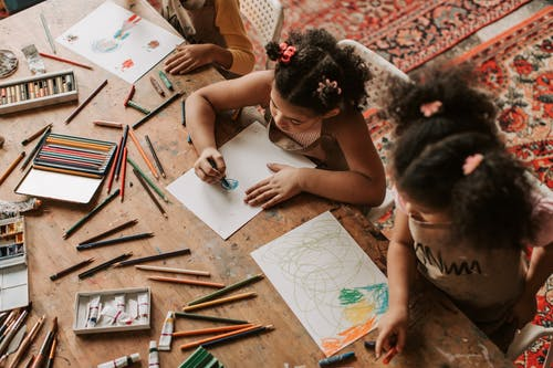 Girls Drawing on White Paper