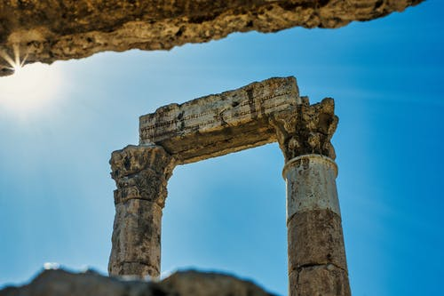 Brown Concrete Pillar Under Blue Sky