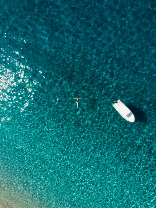 Aerial View of White Boat on Body of Water