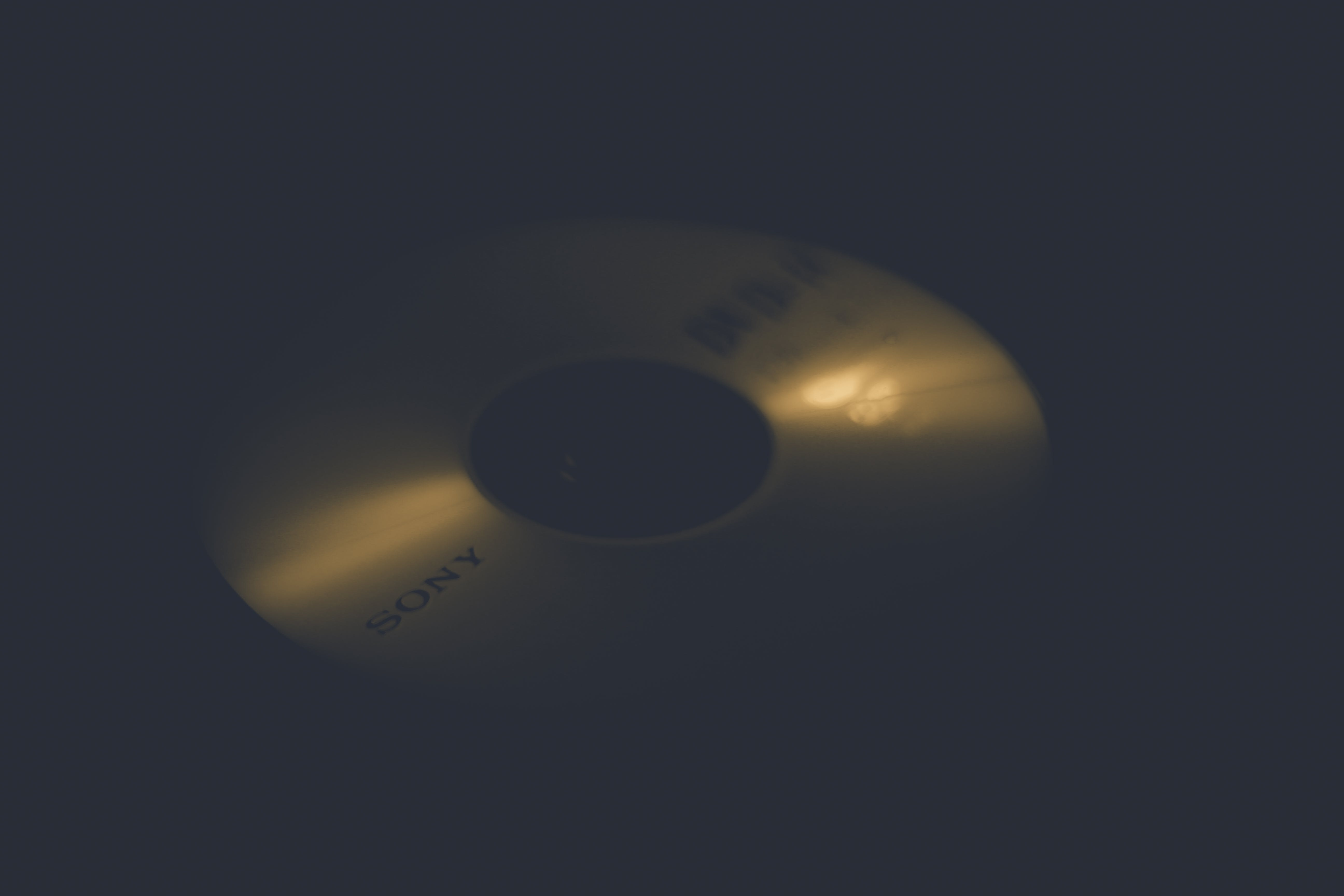 Free stock photo of black background, candlelight, disc, dvd