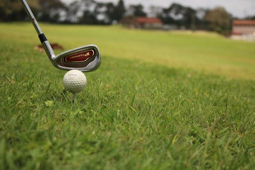 Free stock photo of Golf ball and club