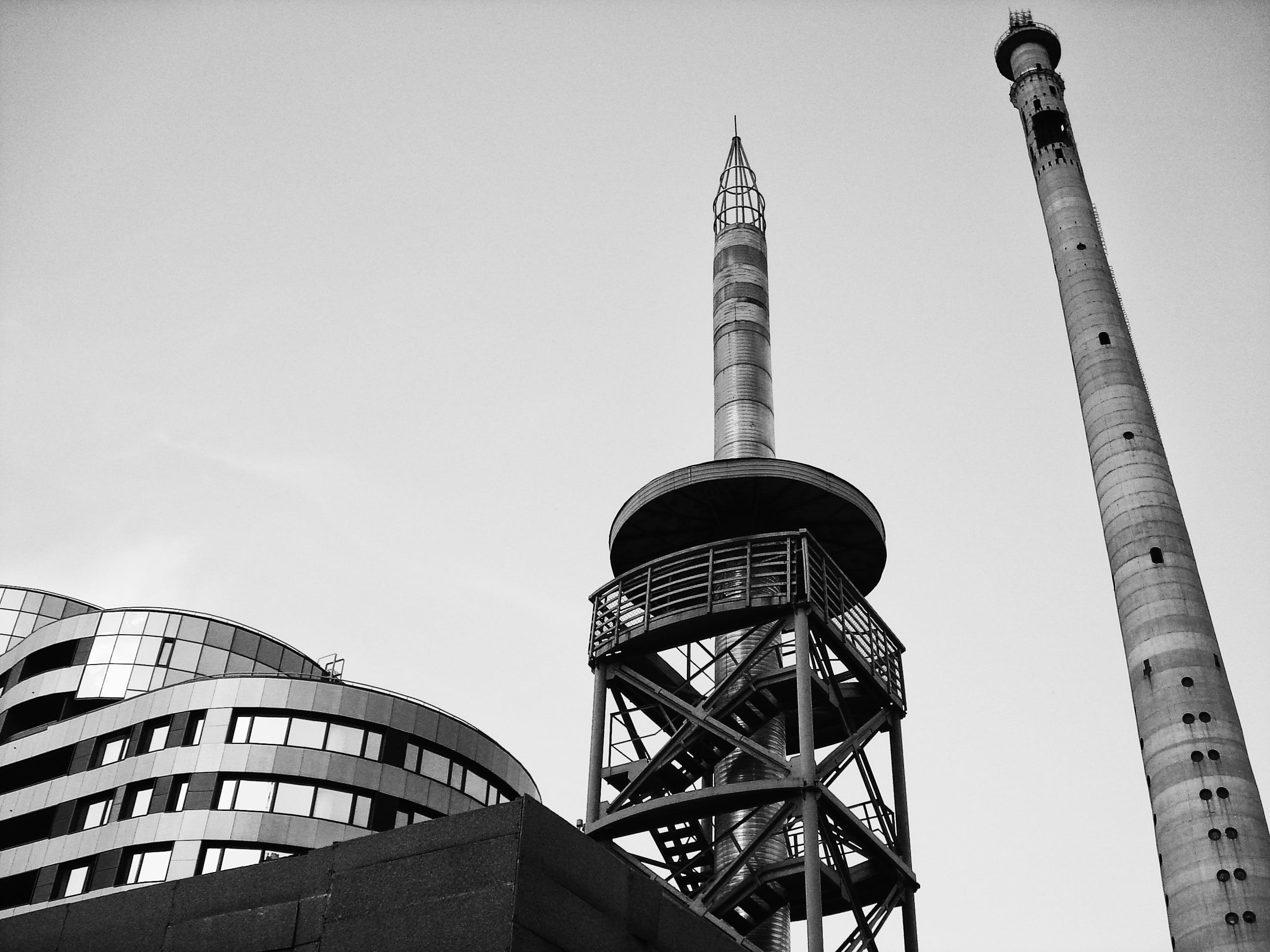 Grayscale Photograph of High-rise Tower