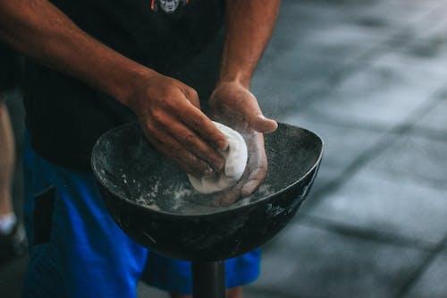 Person Holding White Dough