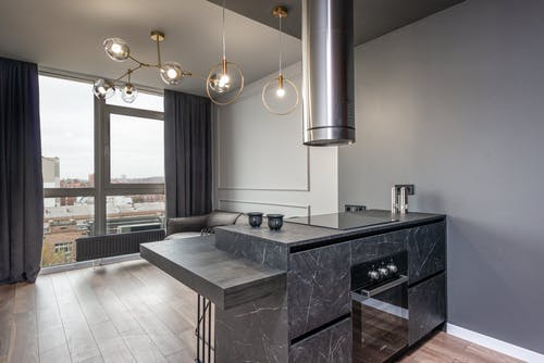 Island kitchen in contemporary minimalist style apartment