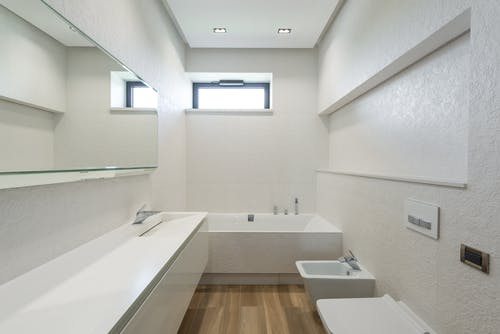 Modern bathroom interior with white walls and furniture