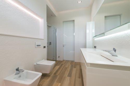 Spacious bathroom interior with white furniture