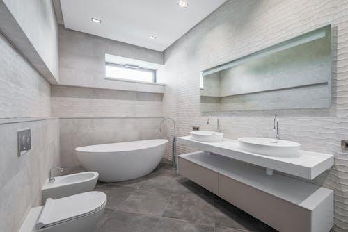 Luxury bathroom interior with white furniture