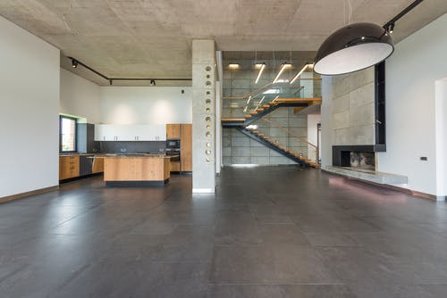 Spacious loft hallway and open plan kitchen in contemporary house with minimalist luxury style interior design