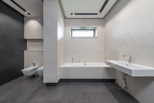 Interior of modern bathroom with white walls