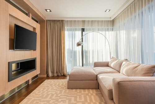 Spacious living room with TV