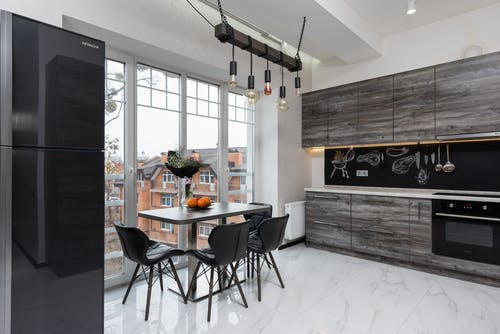 Modern kitchen with table and appliances
