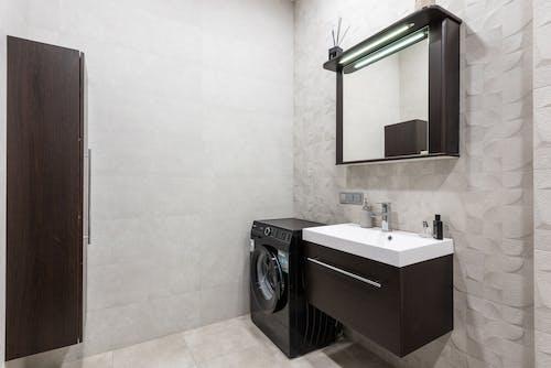 Bathroom with washing machine and sink