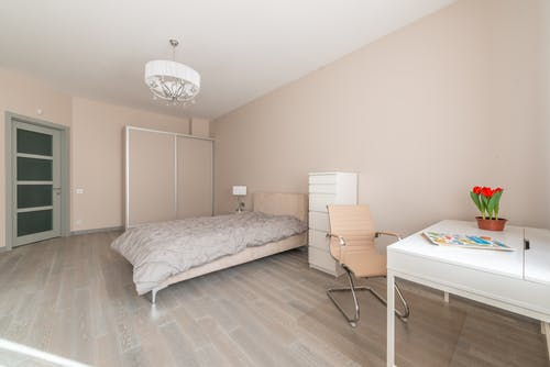 Bedroom interior with table and bed